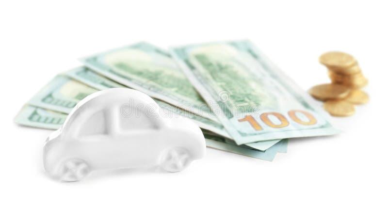 Stuk speelgoed en geld op witte achtergrond royalty-vrije stock afbeelding