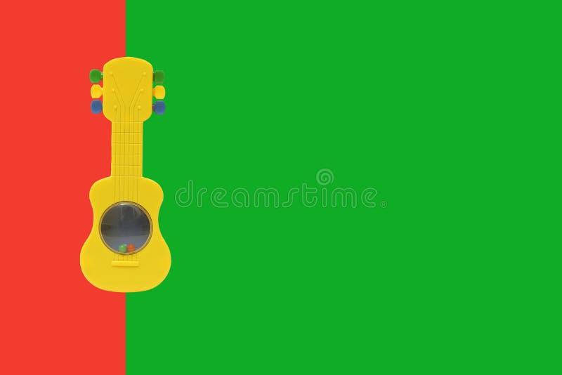 Stuk speelgoed gitaar royalty-vrije stock foto's