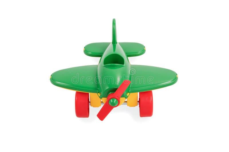 Stuk speelgoed groen vliegtuig stock afbeelding