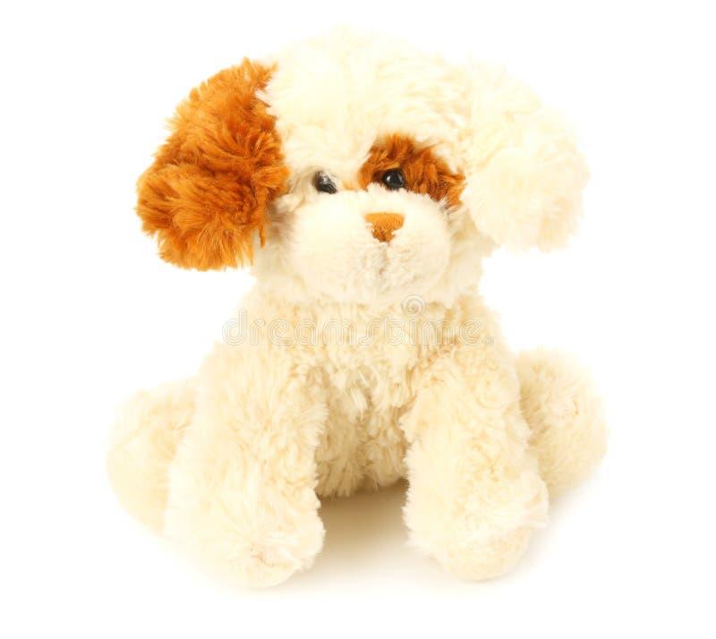 Stuk speelgoed hond op een witte achtergrond wordt ge?soleerd die royalty-vrije stock afbeeldingen