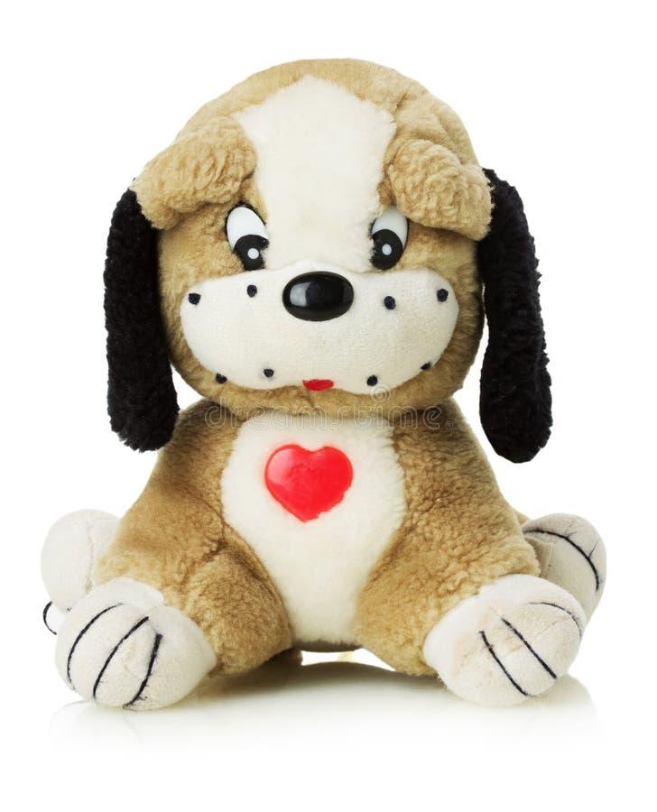 Stuk speelgoed hond op witte achtergrond royalty-vrije stock afbeelding