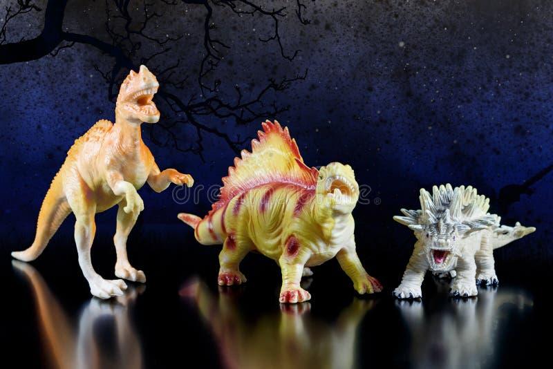 Stuk speelgoed modellen van dinosaurussen royalty-vrije stock fotografie
