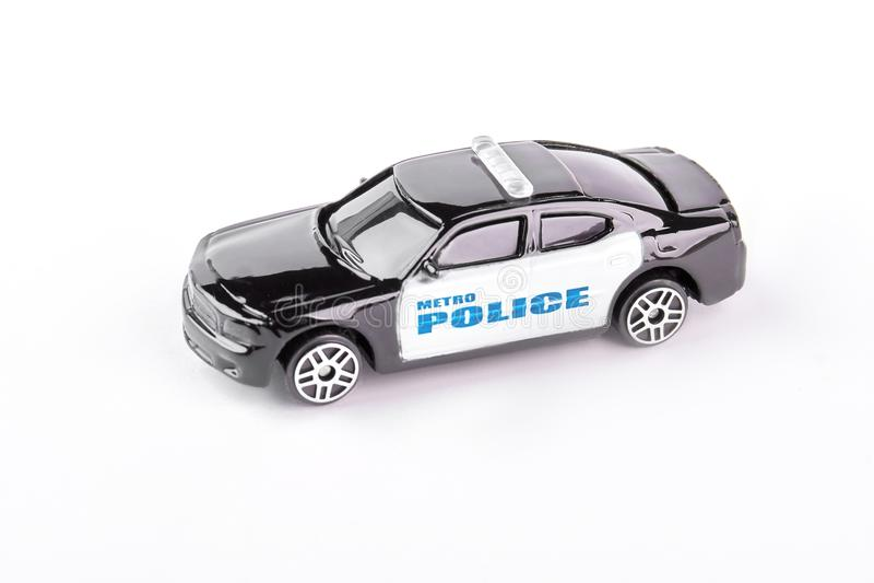 Stuk speelgoed politiewagen op witte achtergrond wordt geïsoleerd die royalty-vrije stock afbeeldingen