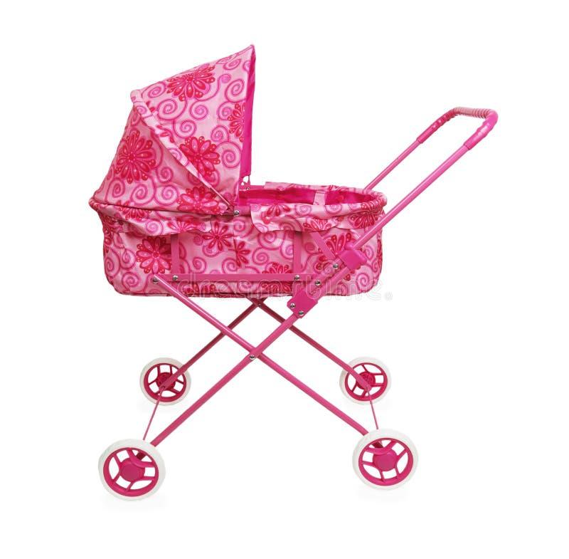 Stuk speelgoed roze kinderwagen stock foto