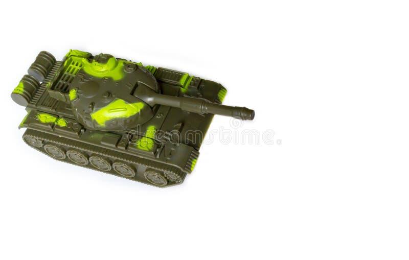Stuk speelgoed tank op een witte achtergrond royalty-vrije stock afbeeldingen