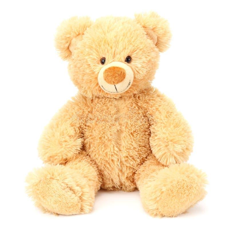Stuk speelgoed teddybeer die op witte achtergrond wordt geïsoleerd royalty-vrije stock foto