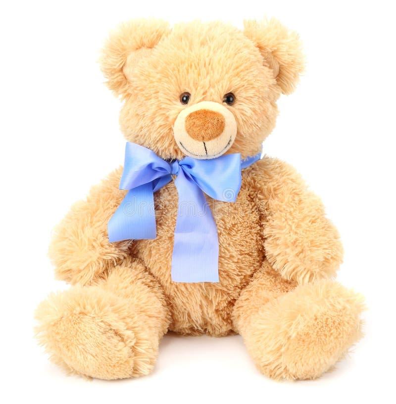 Stuk speelgoed teddybeer die op witte achtergrond wordt ge?soleerd royalty-vrije stock afbeelding