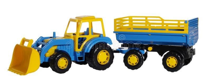 Stuk speelgoed tractor met een aanhangwagen stock afbeeldingen