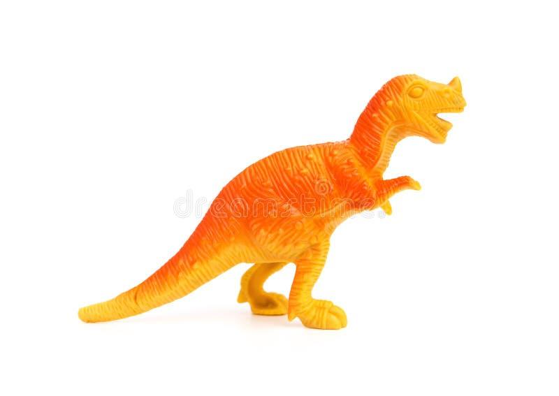 Stuk speelgoed van de zijaanzicht het oranje plastic dinosaurus op witte achtergrond royalty-vrije stock afbeelding