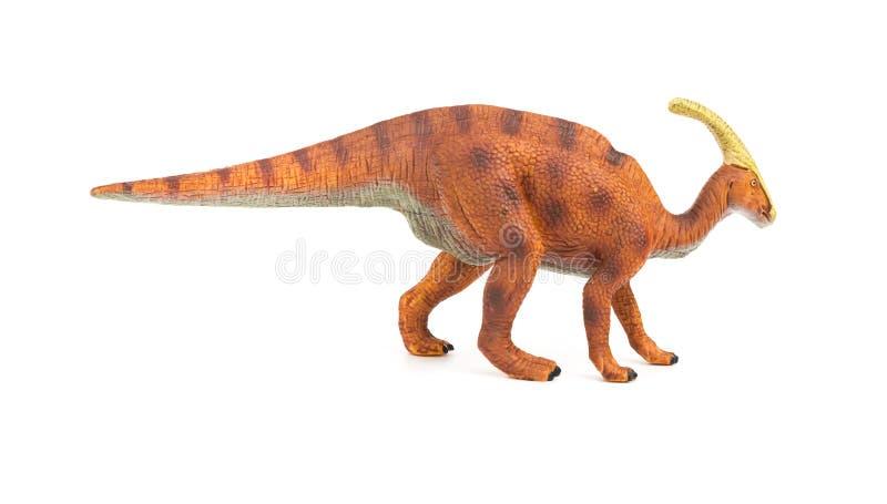 Stuk speelgoed van zijaanzicht het bruine Parasaurolophus op witte achtergrond stock foto's