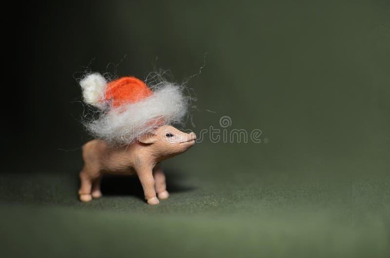 Stuk speelgoed varken in GLB van de Kerstman stock foto