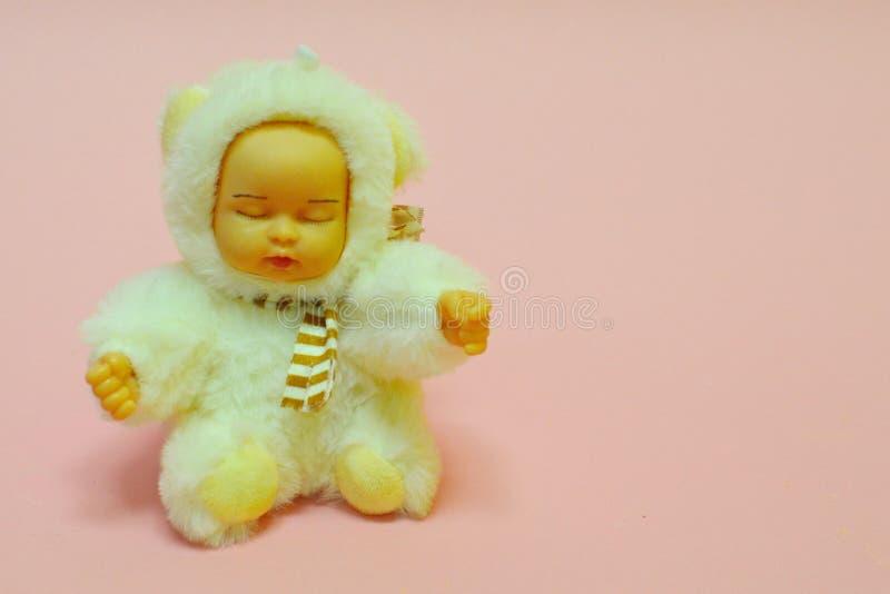 Stuk speelgoed voor het meisje op roze zachte toon royalty-vrije stock fotografie