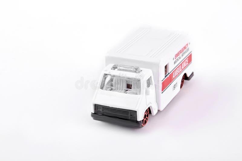 Stuk speelgoed ziekenwagen op witte achtergrond royalty-vrije stock afbeelding