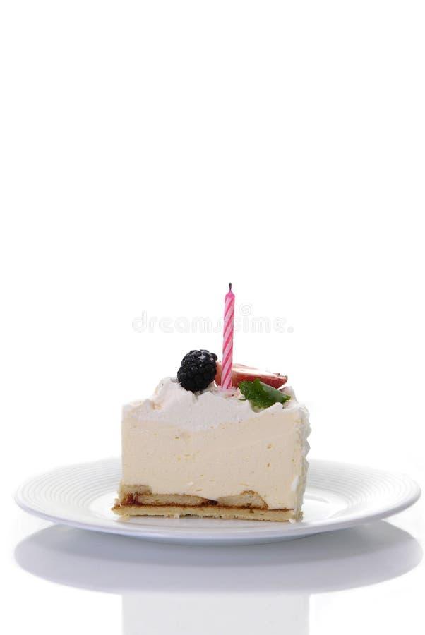 Stuk van cake met kaars stock foto's