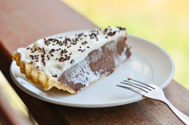 Stuk van cake op lijst stock fotografie