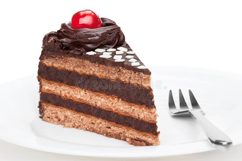 Stuk van chocoladecake met kers wordt verfraaid die stock foto's