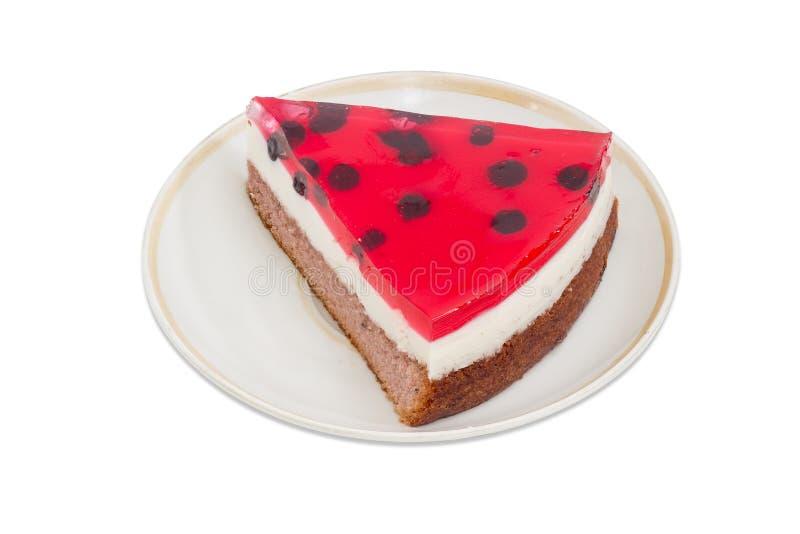 Stuk van gelaagde cake met bessengelei op een schotel royalty-vrije stock fotografie
