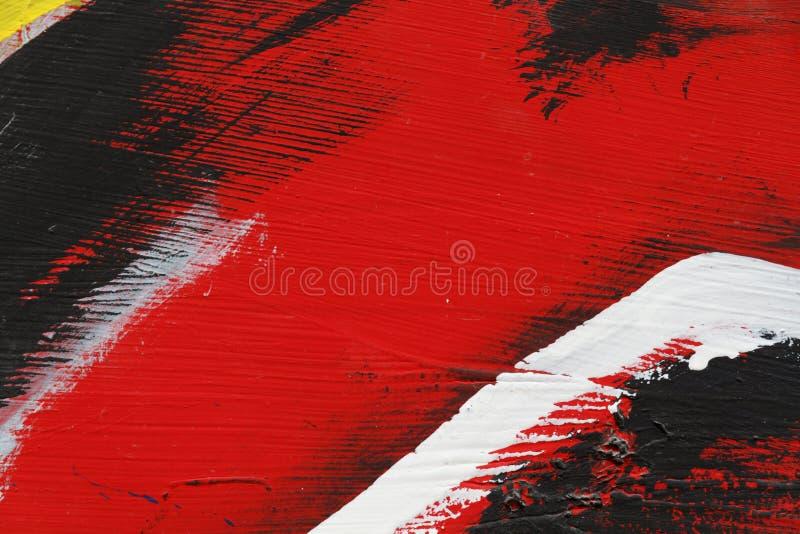 Stuk van geschilderde metaalmuur met zwarte, rode en witte verf stock afbeeldingen