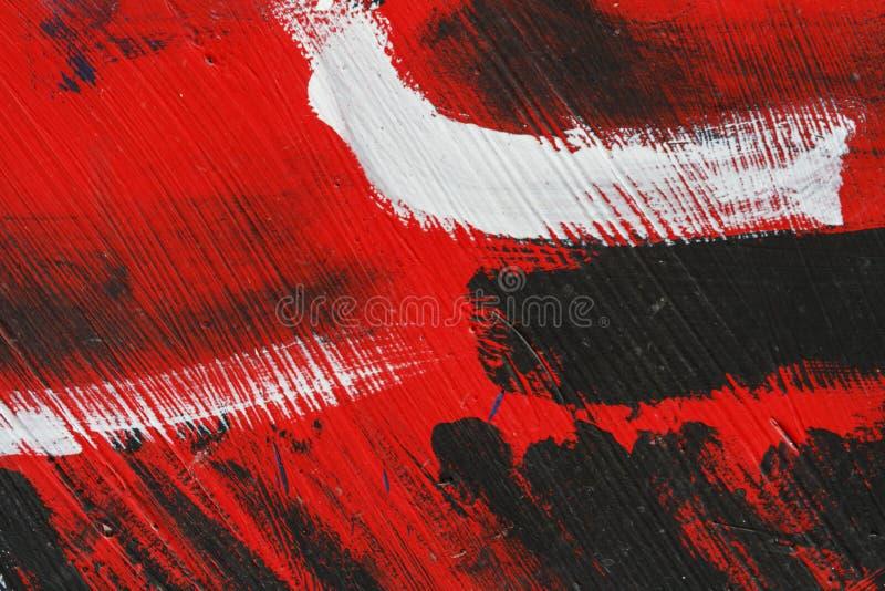 Stuk van geschilderde metaalmuur met zwarte, rode en witte verf stock foto's
