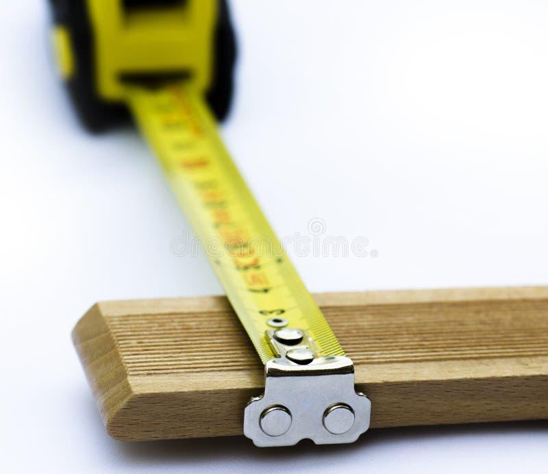 Stuk van houten meting stock afbeeldingen