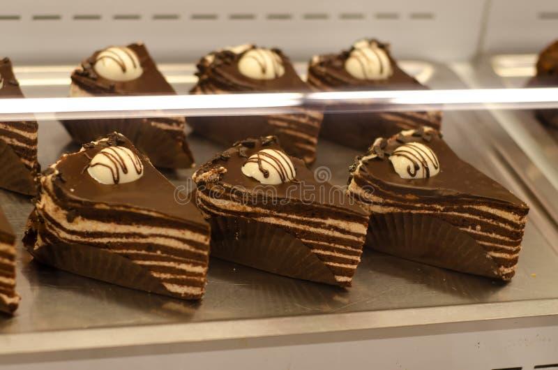Stukken cakes in de opslag stock fotografie