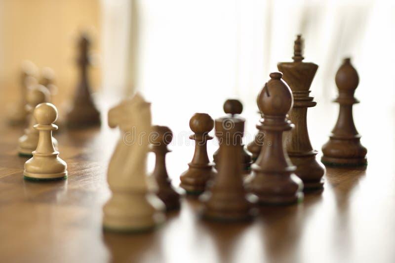 Stukken op schaakraad. stock afbeeldingen