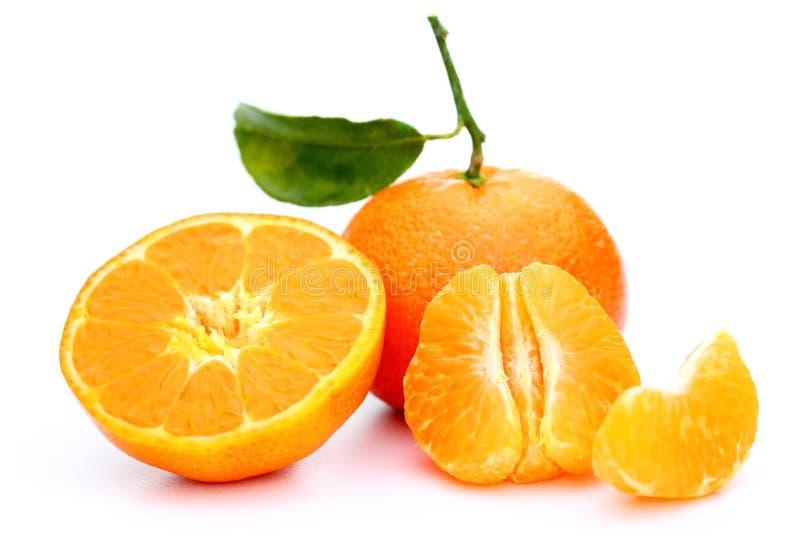 Stukken van een clementine stock afbeeldingen