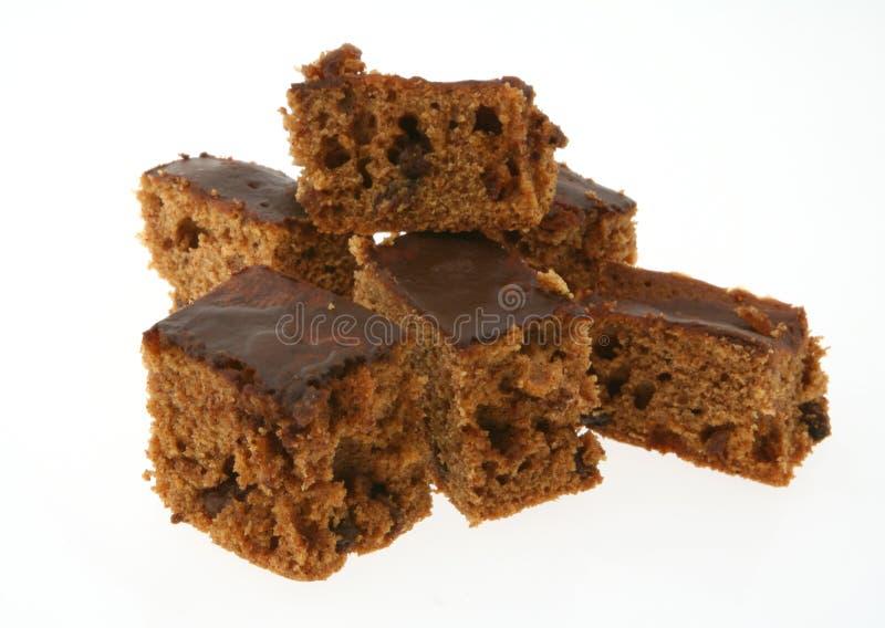 Stukken van gembercake op wit royalty-vrije stock foto
