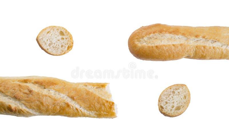 Stukken van lange brood of baguette op witte achtergrond royalty-vrije stock fotografie
