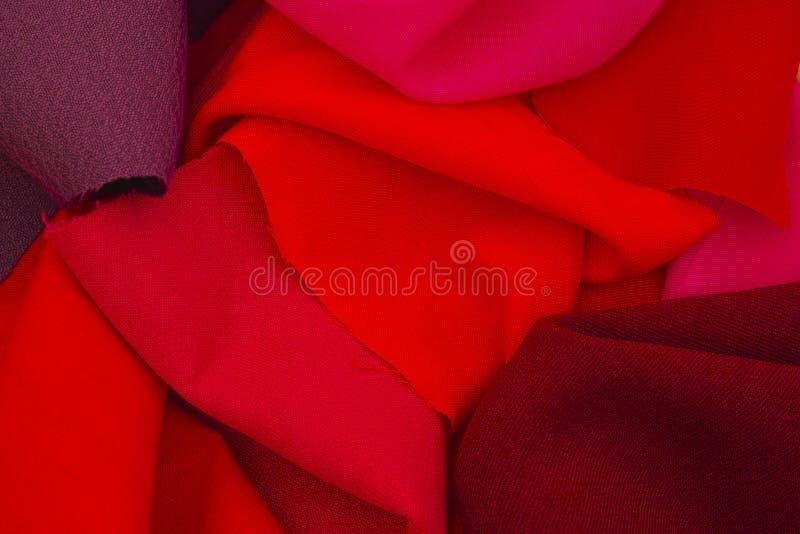 Stukken van rode textiel stock afbeeldingen