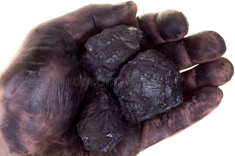 Stukken van steenkool in vuile palm royalty-vrije stock afbeelding