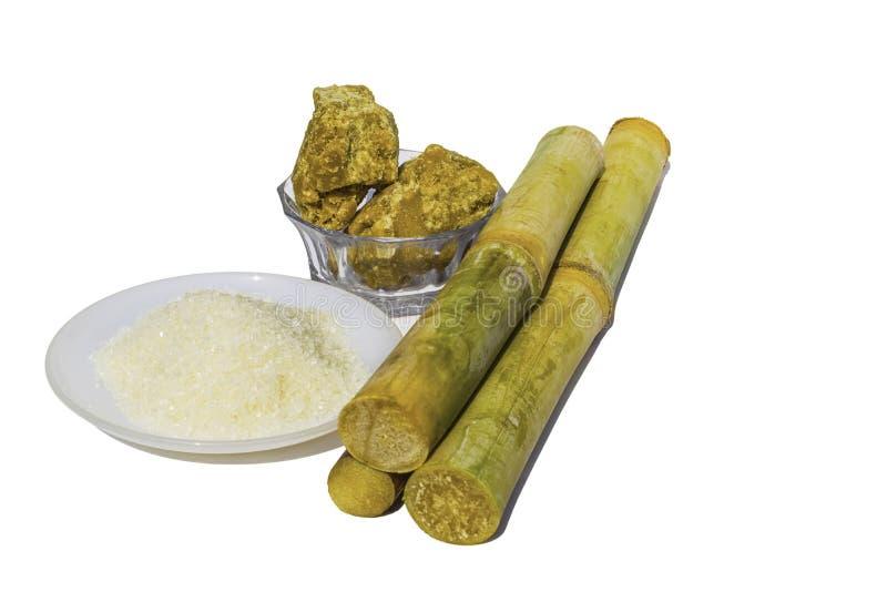 Stukken van suikerriet met witte suiker stock afbeeldingen