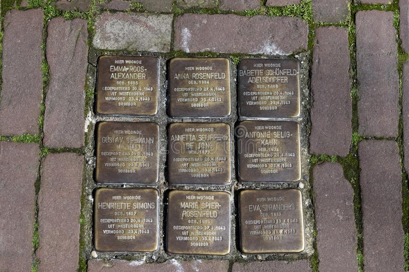 Stumbling stones, or stolpersteine are memorial brass plates placed into the pavement outside certain houses or deportation zones royalty free stock photos