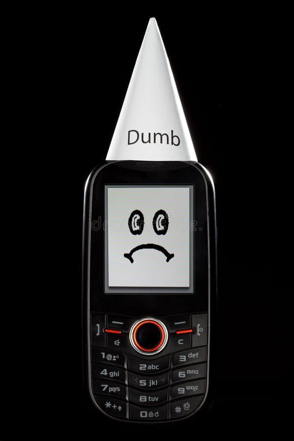 Stummes Telefon mit traurigem Gesichts-und Klassenletzt-Hut stockfotos