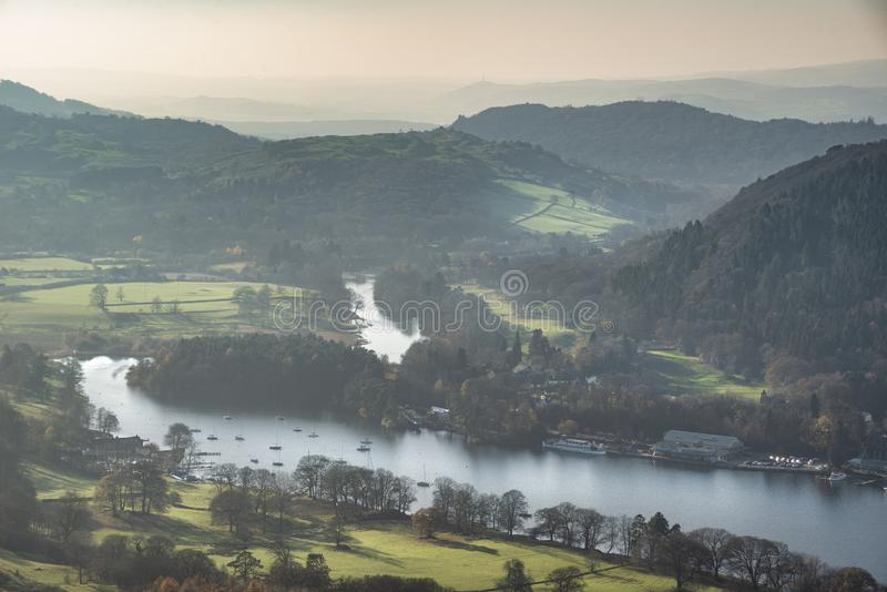Stuning vibrant Autumn Fall landscape image of view from Gummers How down onto Derwent Wter in Lake District. Beautiful Autumn Fall landscape image of view from stock image