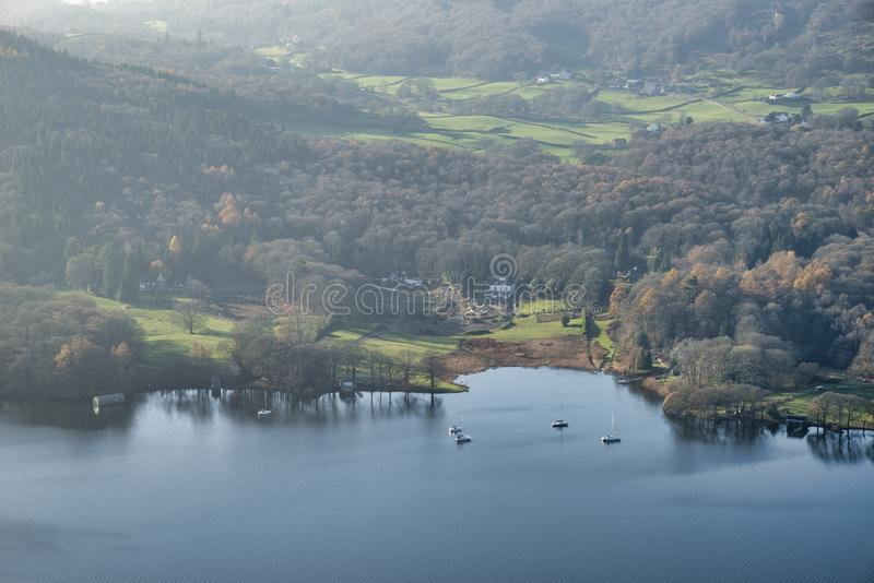 Stuning vibrant Autumn Fall landscape image of view from Gummers How down onto Derwent Wter in Lake District. Beautiful Autumn Fall landscape image of view from stock photos