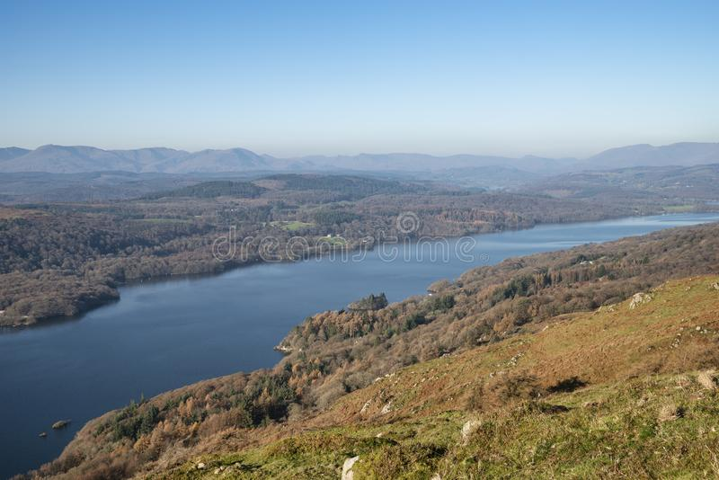 Stuning vibrant Autumn Fall landscape image of view from Gummers How down onto Derwent Wter in Lake District. Beautiful Autumn Fall landscape image of view from royalty free stock images