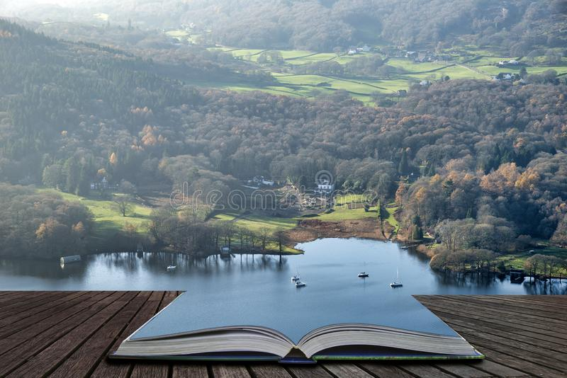 Stuning vibrant Autumn Fall landscape image of view from Gummers How down onto Derwent Wter in Lake District coming out of pages. Beautiful Autumn Fall landscape royalty free stock photo