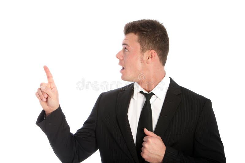 Stunned бизнесмен указывая вверх стоковое изображение rf
