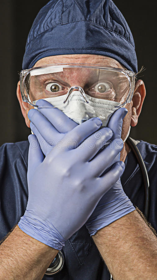 Stunned Doctor or Nurse with Protective Wear and Stethoscope. Stunned Male Doctor or Nurse with Protective Wear and Stethoscope stock images
