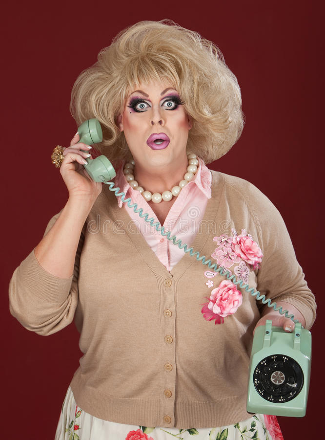 Free Stunned Drag Queen On Phone Call Royalty Free Stock Photos - 24882008
