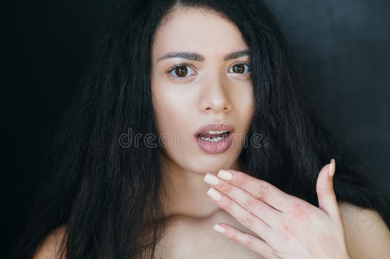 Stunned young woman breaking news omg speechless royalty free stock image