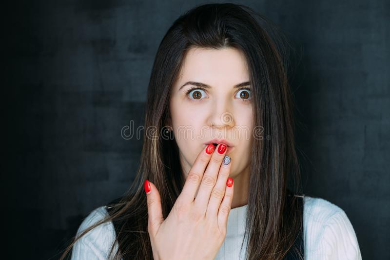 Stunned young woman breaking news omg speechless royalty free stock photography