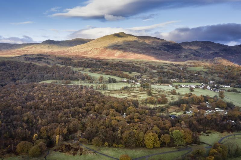 Stunning aerial drone landscape image from in the clouds looking down on hills and valleys on a vibrant Autumn Fall morning stock photography