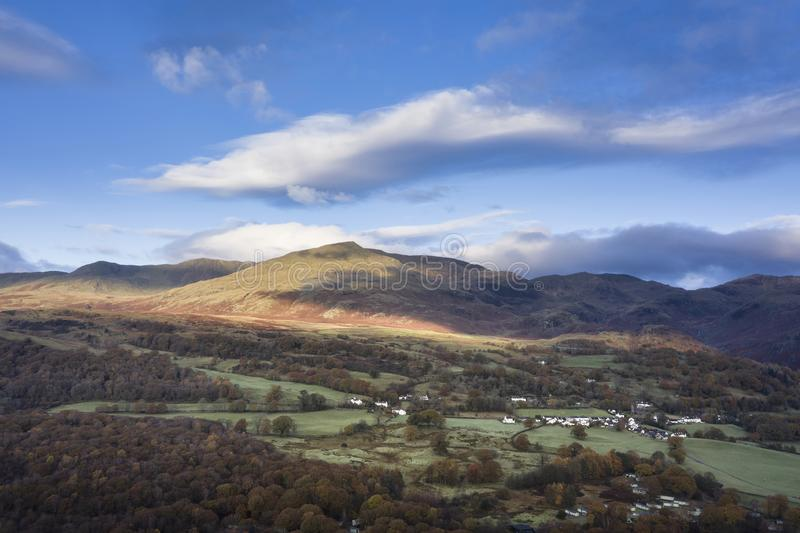 Stunning aerial drone landscape image from in the clouds looking down on hills and valleys on a vibrant Autumn Fall morning royalty free stock photography