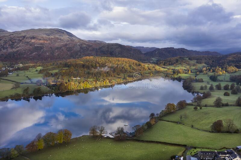 Breathtaking vibrant aerial drone landscape images over Coniston Water at sunrise on beautiful Autumn Fall morning stock photos