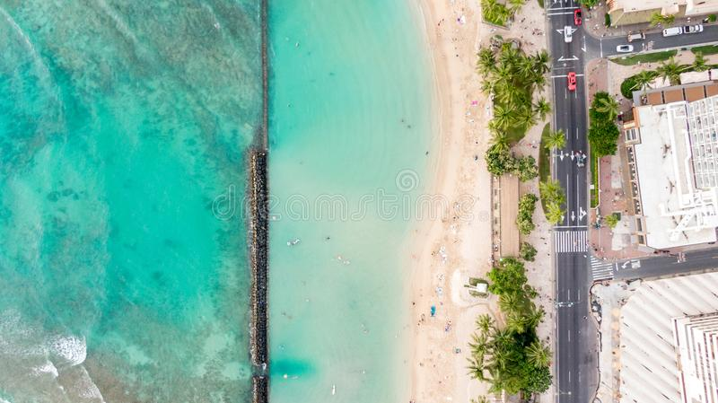 Stunning aerial drone view of Kuhio Beach, part of Waikiki Beach in Honolulu on the island of Oahu, Hawaii. The beach is protected stock image