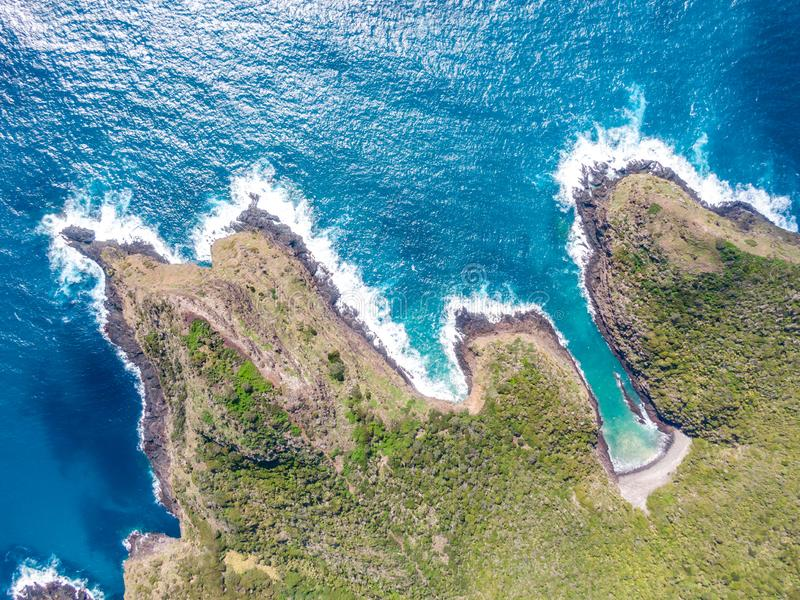 Stunning aerial drone view of Mount Eliza on Lord Howe Island in the Tasman Sea. Beautiful white sand beach. Turquoise water, waves and cliffs. Lord Howe royalty free stock photography
