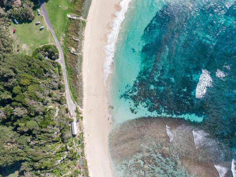 Stunning aerial drone view of Ned`s Beach on Lord Howe Island in the Tasman Sea. Beautiful white sand beach. Turquoise water, waves and corals. Lord Howe stock photos