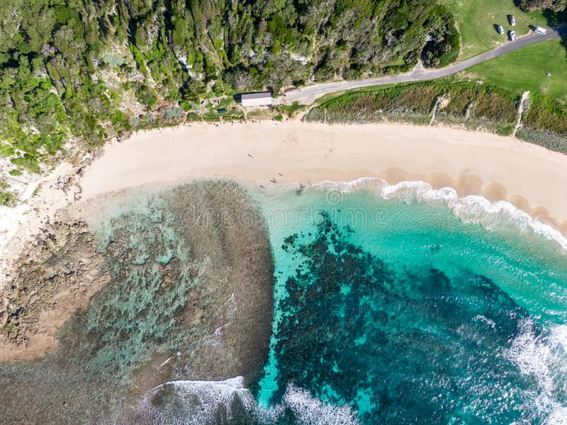 Stunning aerial drone view of Ned`s Beach on Lord Howe Island in the Tasman Sea. Beautiful white sand beach. Turquoise water, waves and corals. Lord Howe stock photo